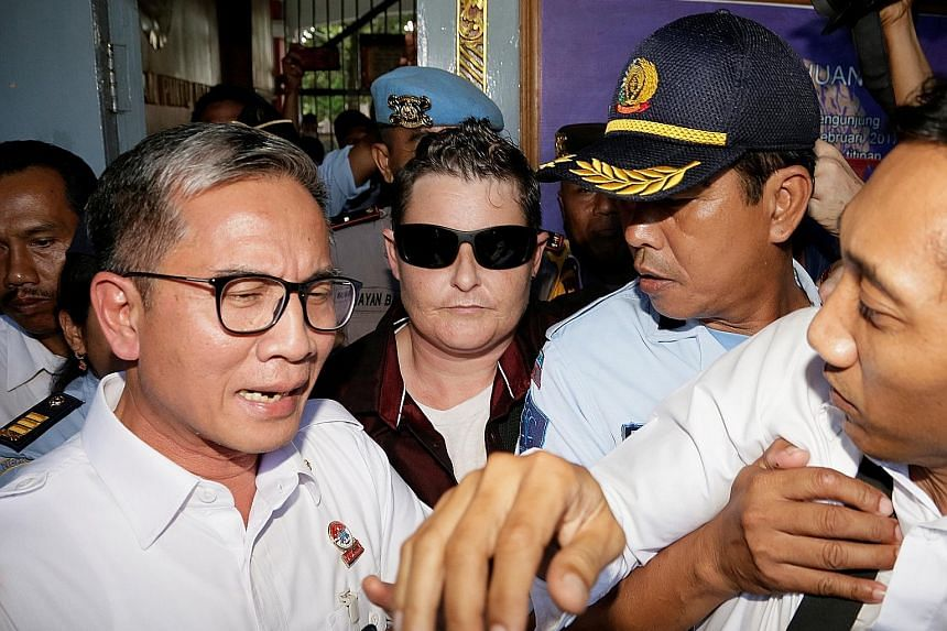 Renae Lawrence (with sunglasses) being released from prison in Bangli Regency, Bali, yesterday. She was taken to a detention centre while waiting for an overnight flight to Sydney.