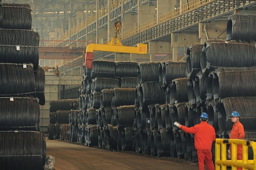 """Employees at a steel plant in Dalian, China's Liaoning province. In a report released on Tuesday, the US said China had not done enough to address its concerns over """"unfair, unreasonable, market-distorting practices""""."""