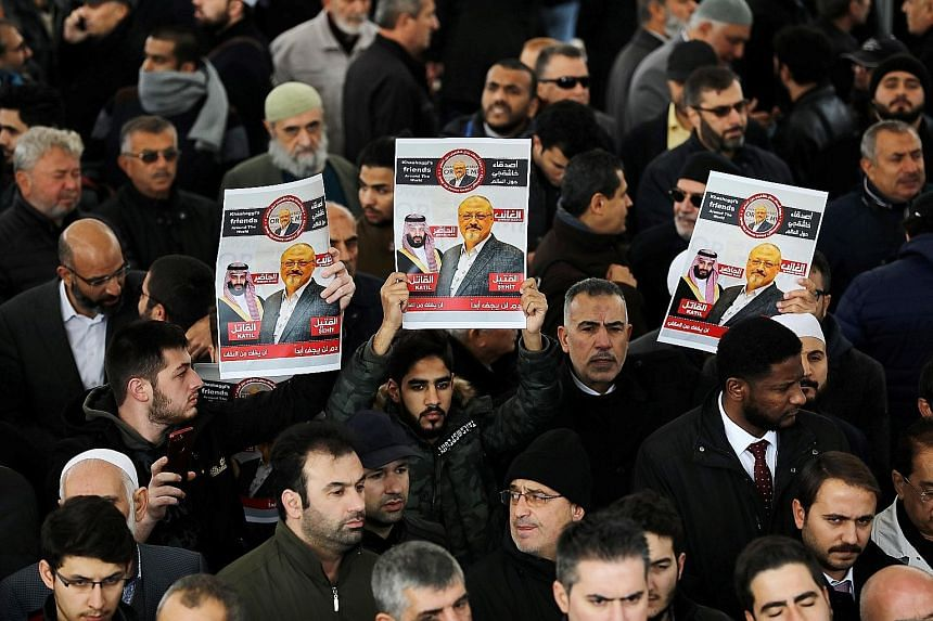 Top: People holding up photos of slain journalist Jamal Khashoggi during funeral prayers at the Fatih mosque in Istanbul last Friday. The CIA believes his death was ordered directly by Crown Prince Mohammed bin Salman (above), Saudi Arabia's de facto