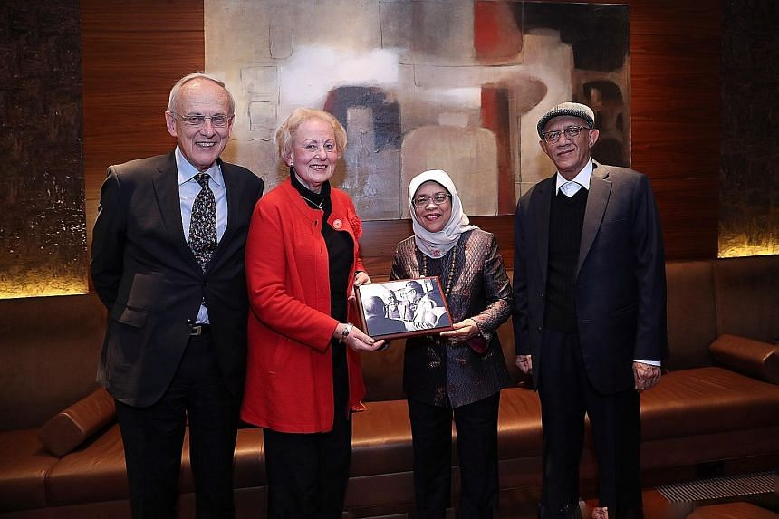 Madam Halimah and her husband, Mr Mohamed Abdullah Alhabshee, with Professor Pieter Winsemius and Ms Ankie Winsemius, the children of the late Dutch economist Albert Winsemius, who was Singapore's chief economic adviser between 1961 and 1984. Madam H