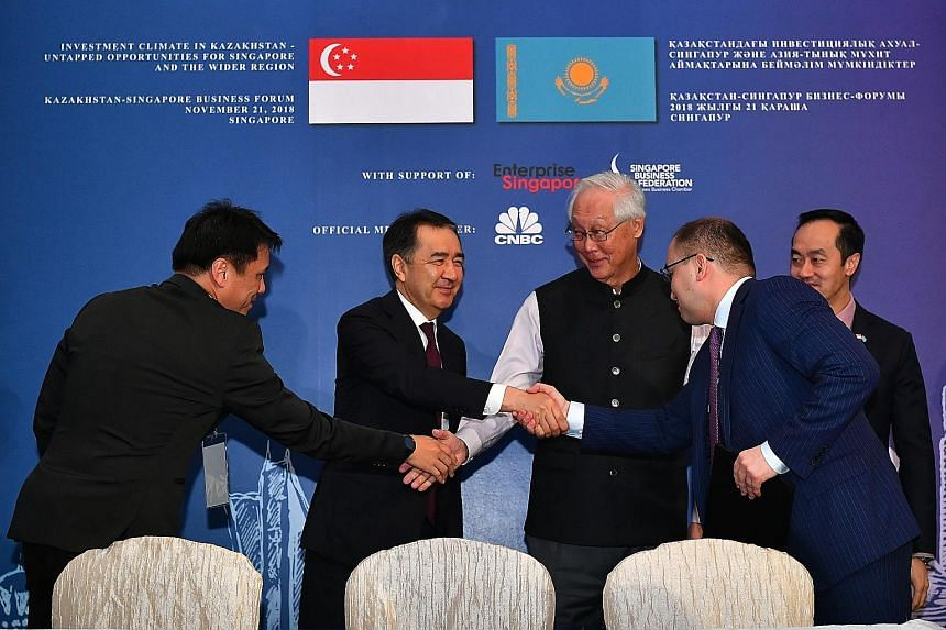 At the Kazakhstan-Singapore Business Forum yesterday were (from left) Singapore Cooperation Enterprise CEO Kong Wy Mun, Kazakh Prime Minister Bakytzhan Sagintayev, Emeritus Senior Minister Goh Chok Tong, Kazakh Minister for Information and Communicat