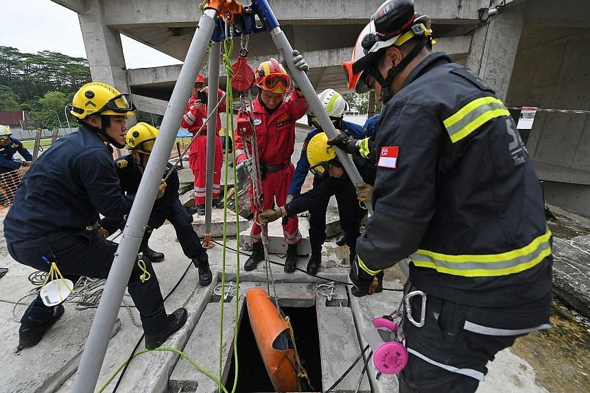 Workshop participants comprising members from Malaysia, Singapore and the Philippines practising rope rescue techniques that they learnt at the three-day Asean Regional Forum Workshop which was held in Singapore. An emergency team from Bangladesh exe
