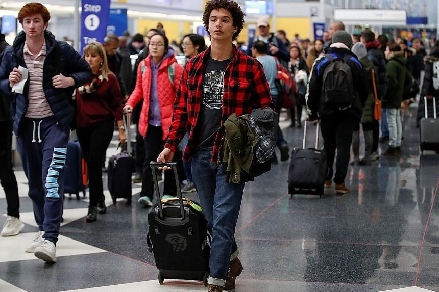 Travellers making their way through Chicago's O'Hare International Airport on Tuesday. Delta Air Lines, United Airlines, and American Airlines, among others, reported robust or even record-breaking ticket sales for the holiday travel period. United s