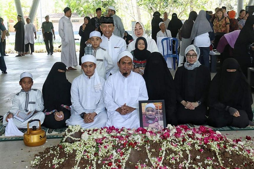 Left: Ms Lia Wiranto is seen in a picture taken at her son's funeral wearing a black niqab (centre, with boy's photo), while her husband wears a white turban and Arabic robes. Below: In a letter to the public, Mr Wiranto says the depth of a person's