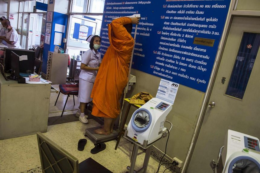 A nurse measuring the height and weight of a Buddhist monk at a government-run hospital for Buddhist monks in Bangkok on Nov 12, 2018.