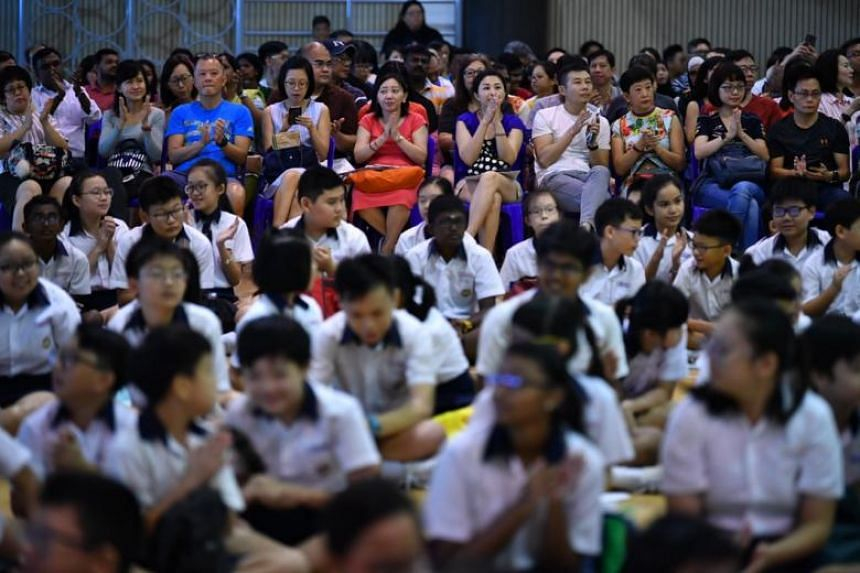 Parents and pupils at Geylang Methodist School (Primary) waiting for the release of the Primary School Leaving Examination results on Nov 22, 2018.