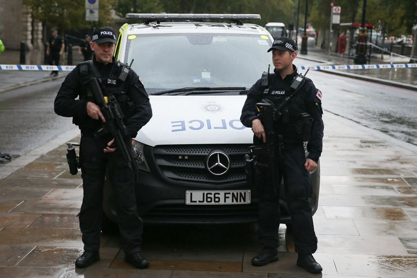 Armed police officers at the scene of a suspicious package in London in October 2018.
