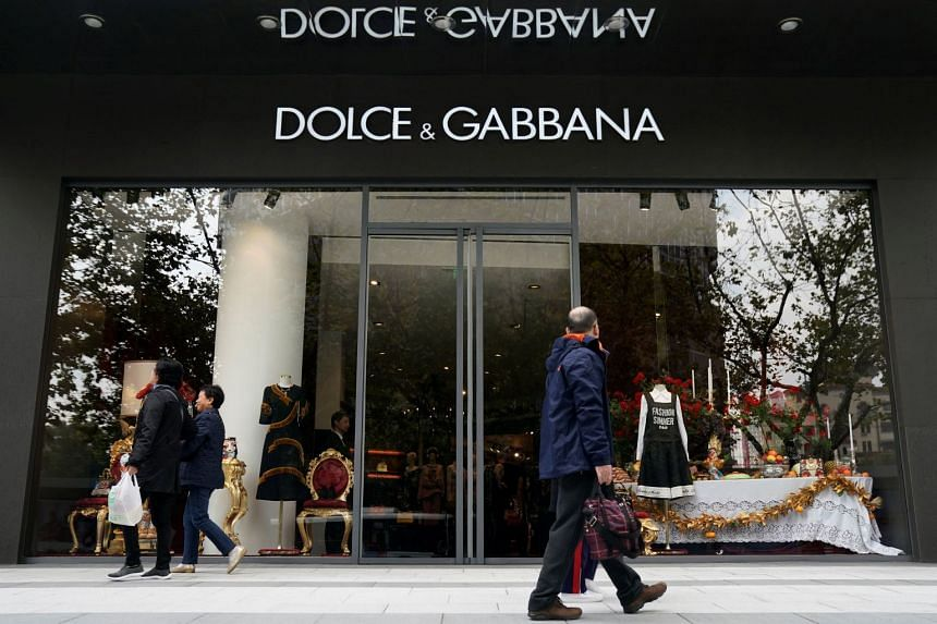 Shoppers walk past a Dolce & Gabbana store in Shanghai on Nov 22, 2018.