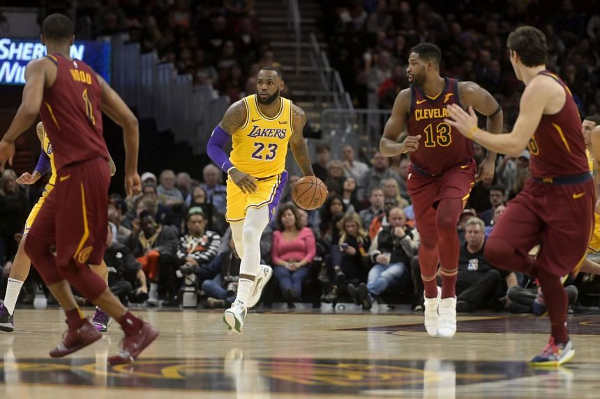 Los Angeles Lakers forward LeBron James (#23) bringing the ball up against the Cleveland Cavaliers during their NBA match on Nov 21, 2018.
