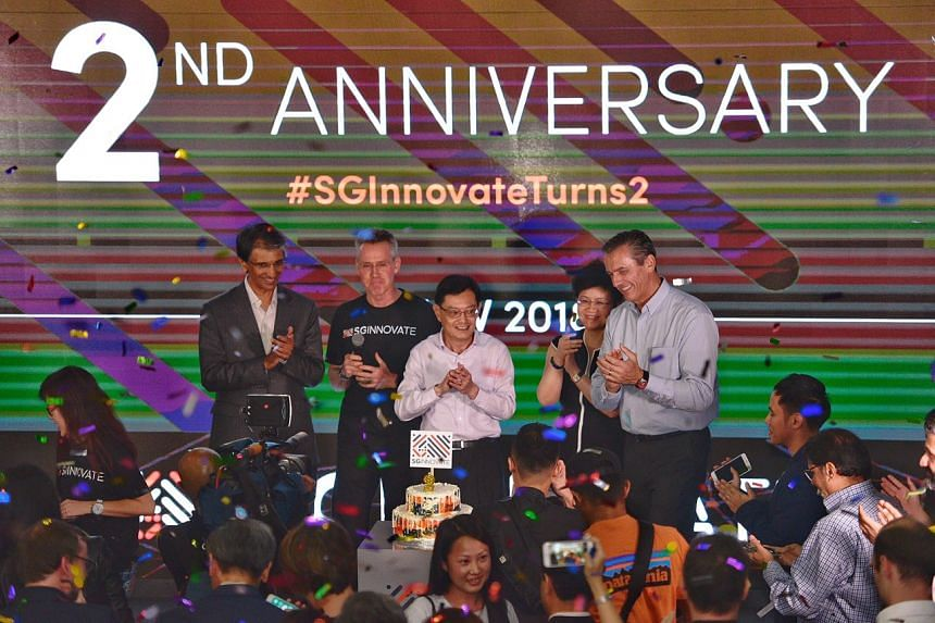 Finance Minister Heng Swee Keat (centre) with (from left) SGInnovate's board member Dilhan Pillay Sandrasegara, founding CEO Steve Leonard, chairman Yong Ying-I and board member Jean-Luc Butel at a ceremony marking the second anniversary of SGInnovat