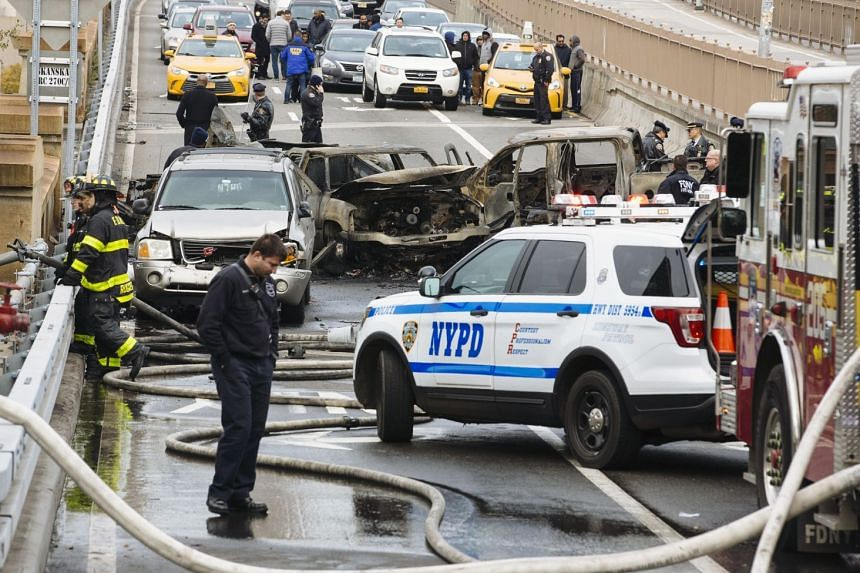 First responders on the scene of the fatal car accident on the Brooklyn Bridge in New York.