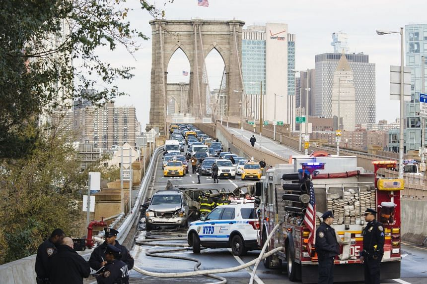 Traffic is backed up to Manhattan following a fatal car accident on the Brooklyn Bridge in New York.