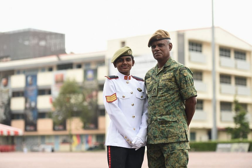 Third Sergeant Ranjitha Ramachandran, 21, with her father, First Warrant Officer Ramachandran Pattani, 57, who has been a regular since 1979, at Pasir Laba Camp on Nov 22, 2018.