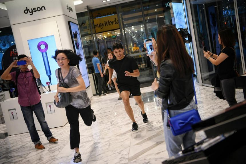 Shoppers sprinting into Robinsons The Heeren right after the doors opened during a 2017 Black Friday sale. ST PHOTO: MARK CHEONG