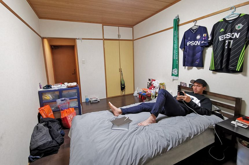 From top: Anders Aplin, on loan from Geylang International, winding down in Matsumoto Yamaga's dormitory that he shares with the club's youth players. The room has been home for the Singapore international for the last four months. Aplin taking a pho