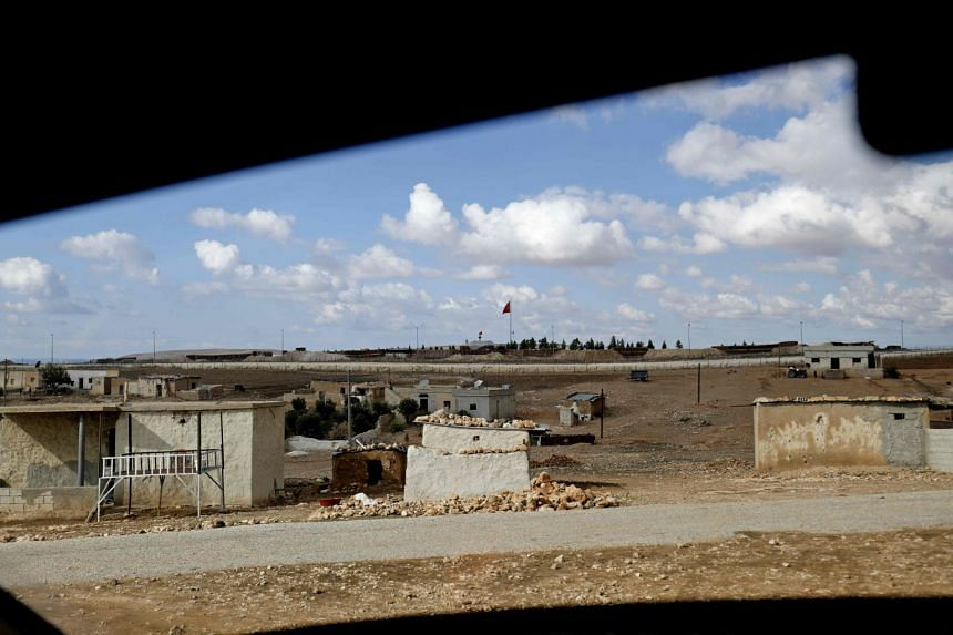 A Turkish flag flies at a military post in the countryside village of Ashma near the border with Turkey in the Kurdish city of Kobane in northern Syria on Nov 8, 2018.