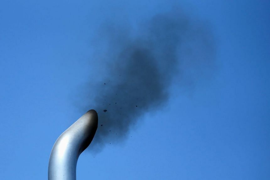 A truck engine is tested for the pollution exiting its exhaust pipe in the US.