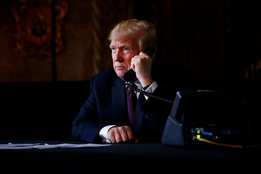 Mr Trump speaking via video teleconference with troops from his Mar-a-Lago estate in Palm Beach, Florida.