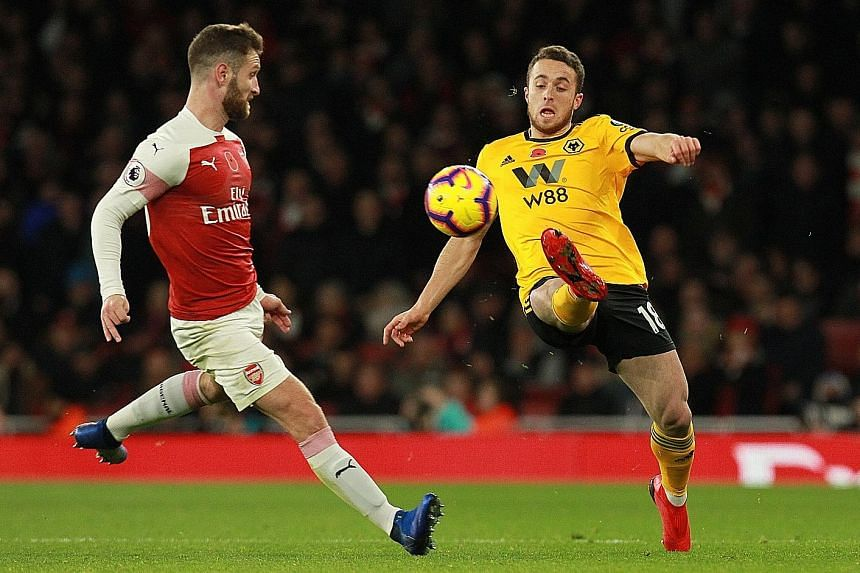 Arsenal's Shkodran Mustafi and Wolves' Diogo Jota in action during a recent English Premier League match at the Emirates stadium.