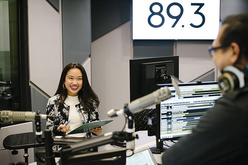 Producer Nadirah Zaidi prepares for The Breakfast Huddle show on Money FM 89.3, SPH Radio's newest station, which was launched in January.