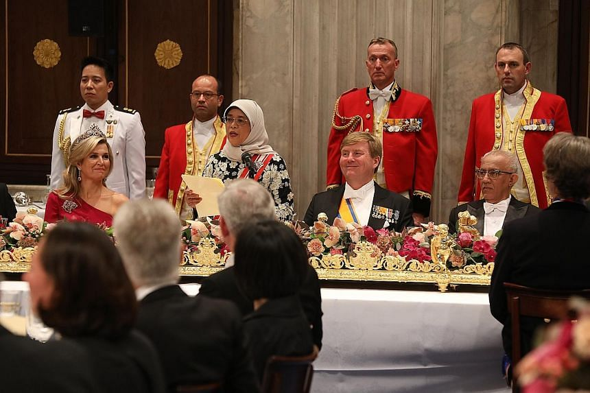 President Halimah Yacob, flanked by King Willem-Alexander and Queen Maxima, speaking at the state banquet on Wednesday. Nearly 200 people were present at the banquet held in honour of President Halimah, who is on a five-day state visit to the Netherl