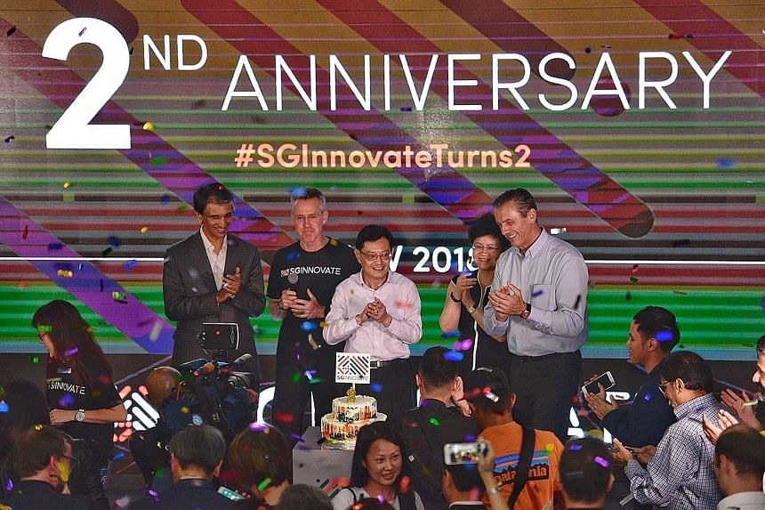 Finance Minister Heng Swee Keat (centre) at SGInnovate's second anniversary celebration yesterday with (from left) board member Dilhan Pillay Sandrasegara, CEO Steve Leonard, chairman Yong Ying-I and board member Jean-Luc Butel.