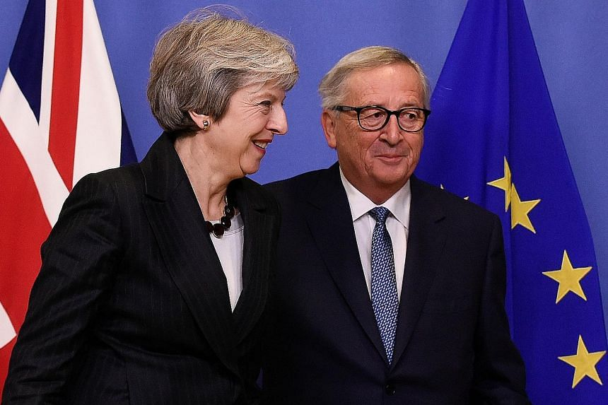 British Prime Minister Theresa May and EU Commission president Jean-Claude Juncker after their meeting at the EU's headquarters in Brussels on Wednesday.