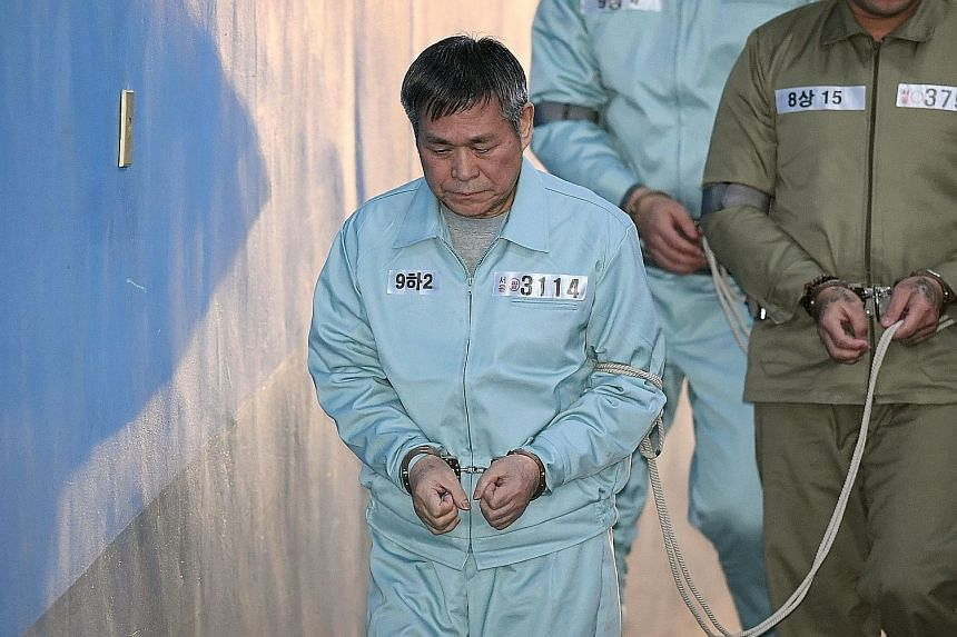 Lee Jaerock arriving at the Seoul Central District Court yesterday. The 75-year-old South Korean cult leader was jailed for eight years after being convicted of the multiple rape of eight female followers. He denied the charges.