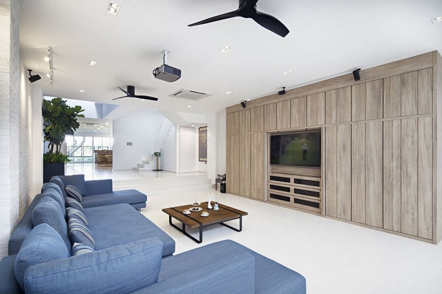 Homeowners Jean Tan, 50, and Jonathan Ng, 52, opted for an open-concept home layout with no partition walls between the rooms in their intermediate terrace house in Bedok. They have 16 ceiling fans installed in their house.
