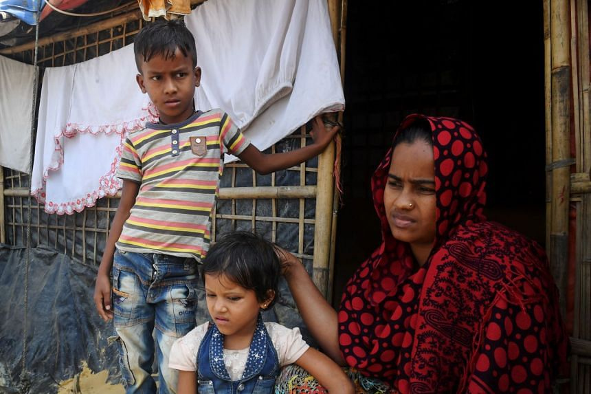 Rohingya refugee Shabeda Begum, with her two children, said she was approached by another refugee offering to reunite her with a sister and brother-in-law in Malaysia.