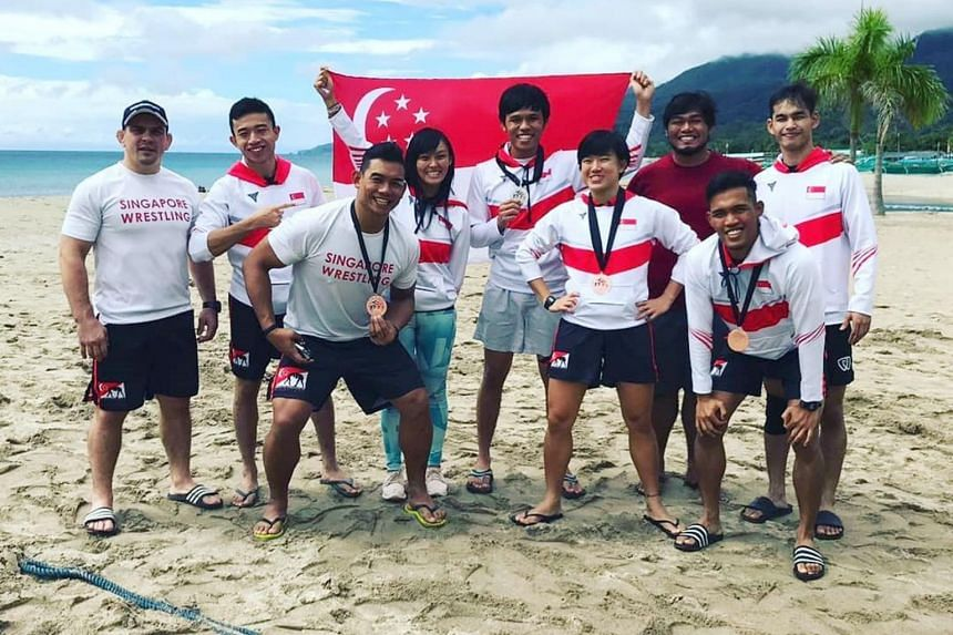 The Singapore team at the SEA Wrestling Championship.