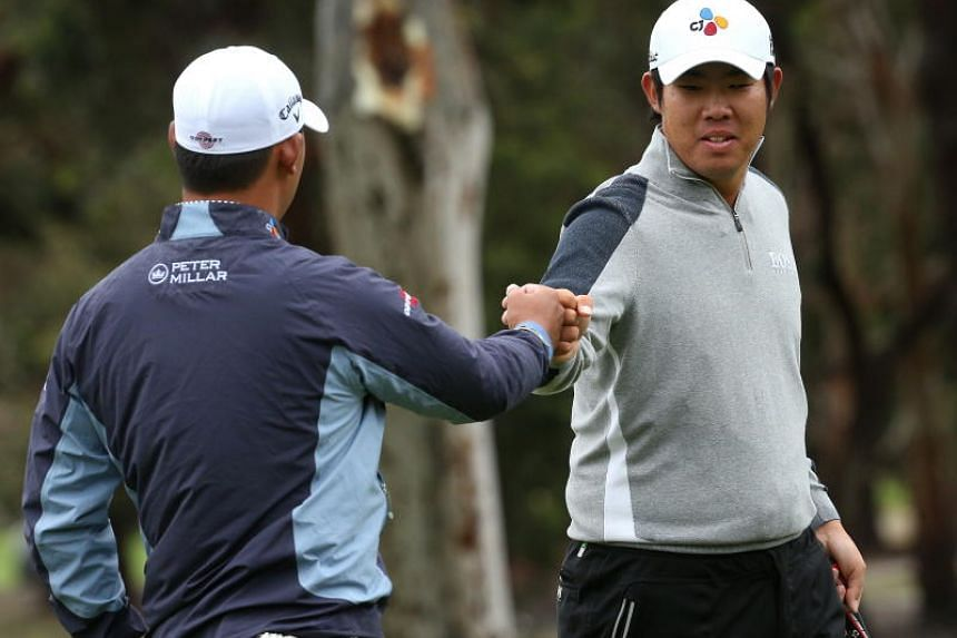 South Korea's Kim Si-woo (left) and An Byeong-hun combined for a 72 in the second round of the World Cup of Golf on Nov 23, 2018 to share the halfway lead on 10-under 134 with Belgium.