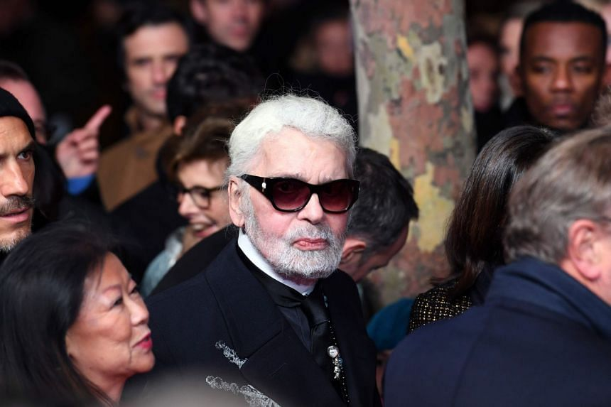 Lagerfeld arrives before launching the Champs Elysees Christmas lights in Paris.
