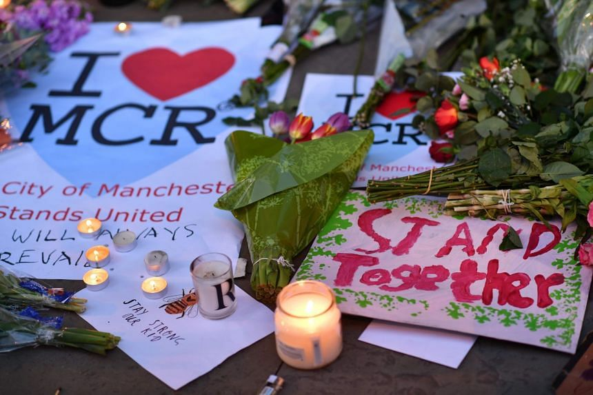 Messages and floral tributes left in Albert Square in Manchester, for those killed and injured in the May 22, 2017 terror attack at an Ariana Grande concert at the Manchester Arena.