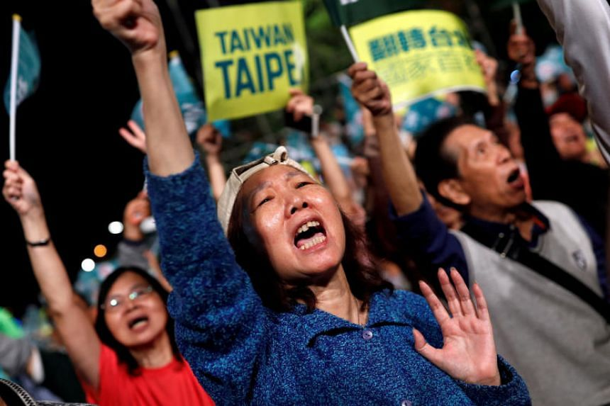 Supporters of the ruling Democratic Progressive Party react during a campaign rally for the local elections in Taipei, Taiwan.