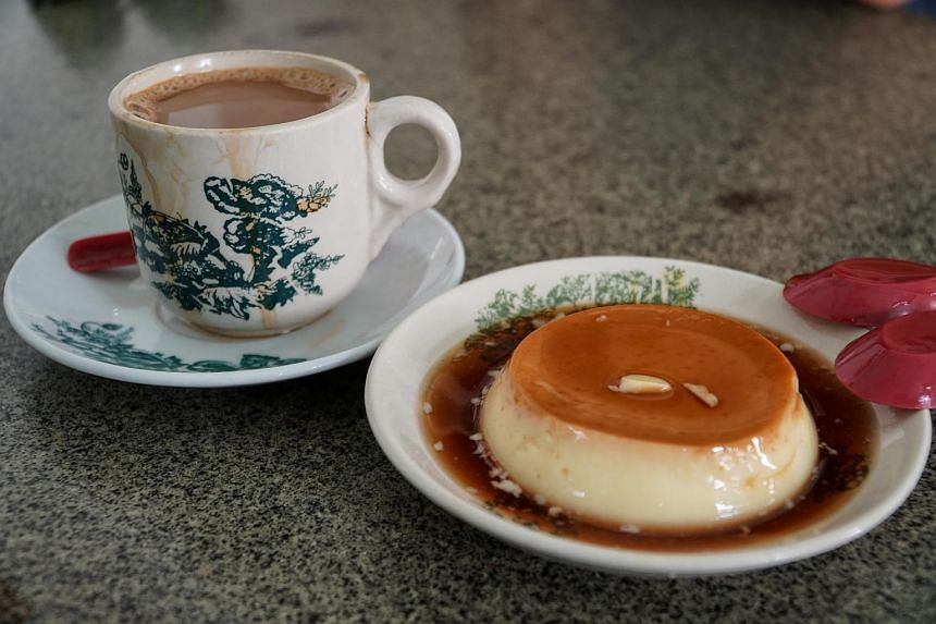 Ipoh specialties include white coffee and custard pudding at Sin Yoon Loong coffee shop.
