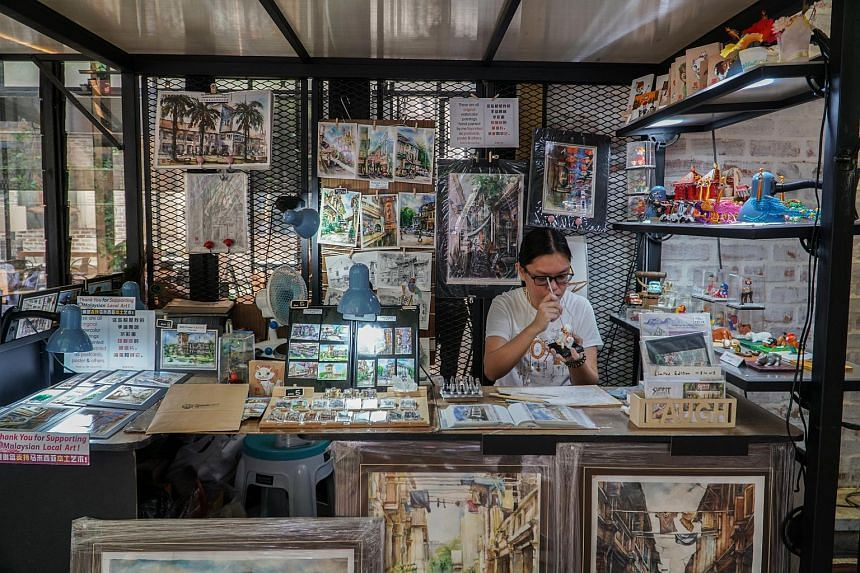 Artists sell their crafts and paintings at small stalls in Ipoh's old town.