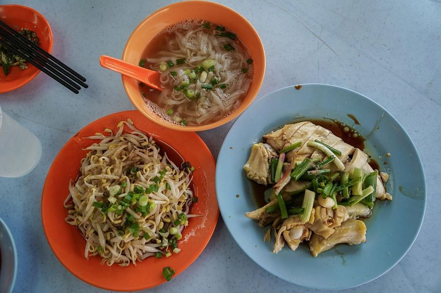Ipoh specialties include kway teow soup, fresh and crunchy beansprouts and poached chicken at the well-known Restoran Lou Wong Tauge Ayam Kuetiau.