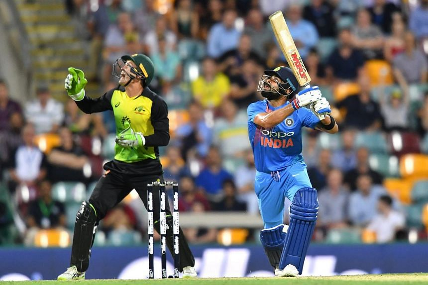 Virat Kohli (right) of India in action during the first Twenty20 (T20) International match between Australia and India, on Nov 21, 2018.