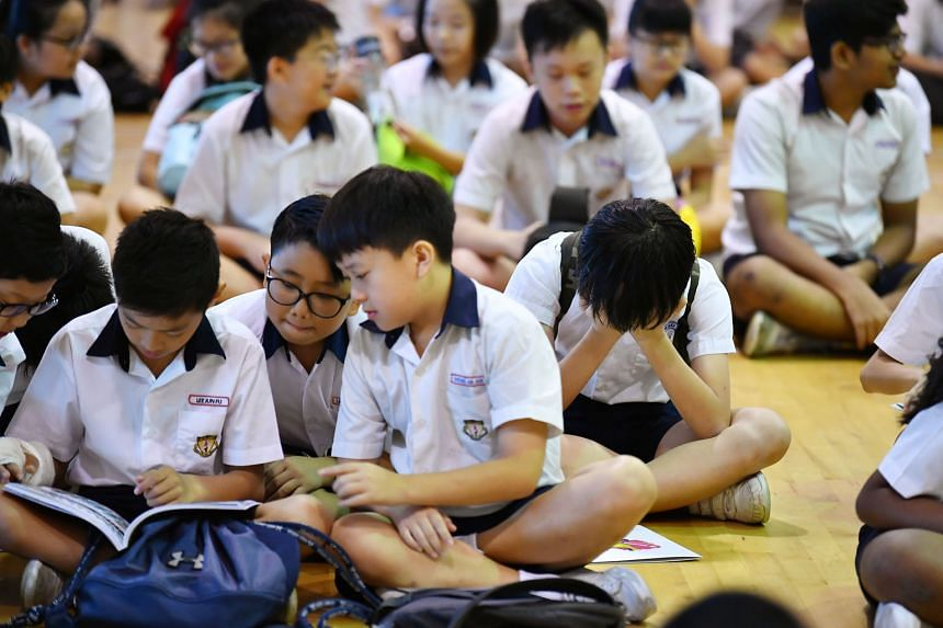 Pupils at Geylang Methodist School (Primary) waiting for the release of their PSLE results yesterday. They were among nearly 40,000 pupils who sat the exam this year.