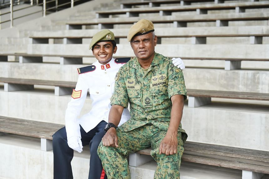 Third Sergeant Ranjitha Ramachandran with her father, First Warrant Officer Ramachandran Pattani, at Pasir Laba Camp yesterday, where 926 specialist cadets graduated to become full-fledged specialists of the Singapore Armed Forces.