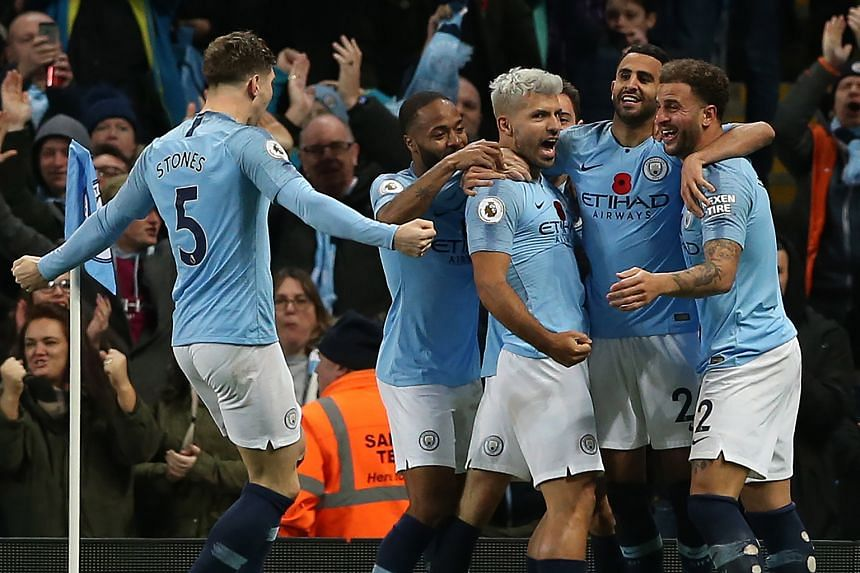Manchester City players celebrating a goal during a Premier League match. Singtel has been the official broadcaster since the 2010-11 season.