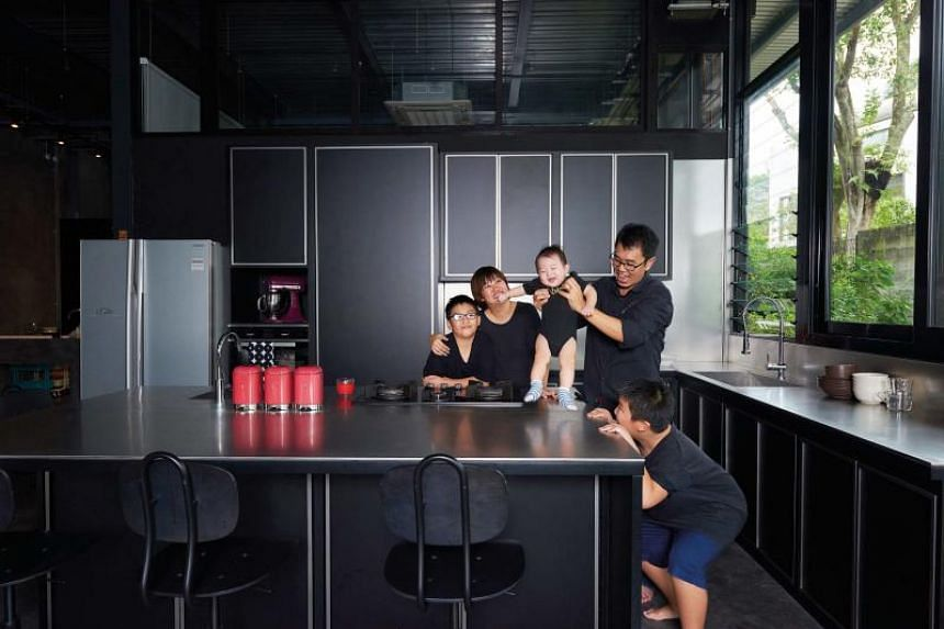 Director of logistics company Alex Lin, 45, his wife Pauline Soo, 44, and their three children Ayden, 11, Kaleb, 10, Eli, 20 months old live in a semi-detached home in Bukit Timah made entirely out of steel and glass.