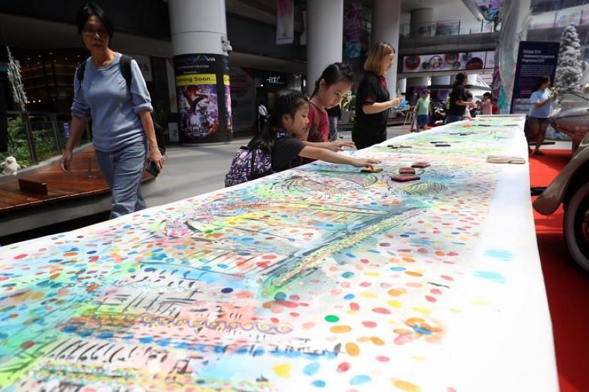 The painting depicts Singapore's growth from a fishing village to a modern metropolis, and imagines the future as well. Pieces of the artwork will travel to different parts of the island for Singaporeans and PRs to contribute their fingerprints.