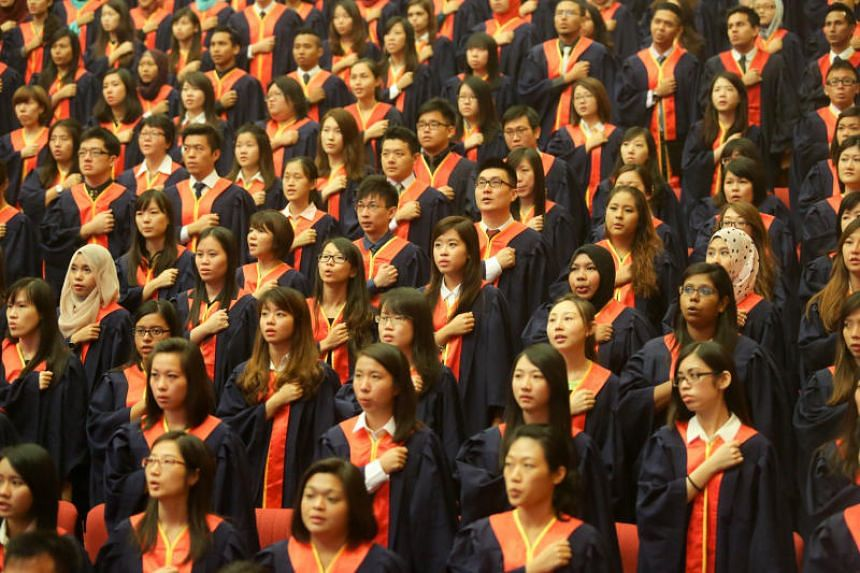 A file photo taken on July 9, 2014, shows National Institute of Education graduates reciting the teacher's pledge during a graduation ceremony.