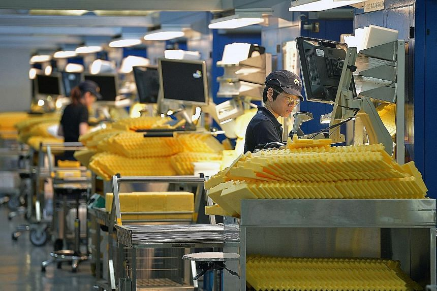 """The MAS noted that trade-related sectors, such as manufacturing, have benefited from firm external demand over the past year. But """"against the backdrop of global economic uncertainties, the general outlook for the manufacturing and services sectors t"""