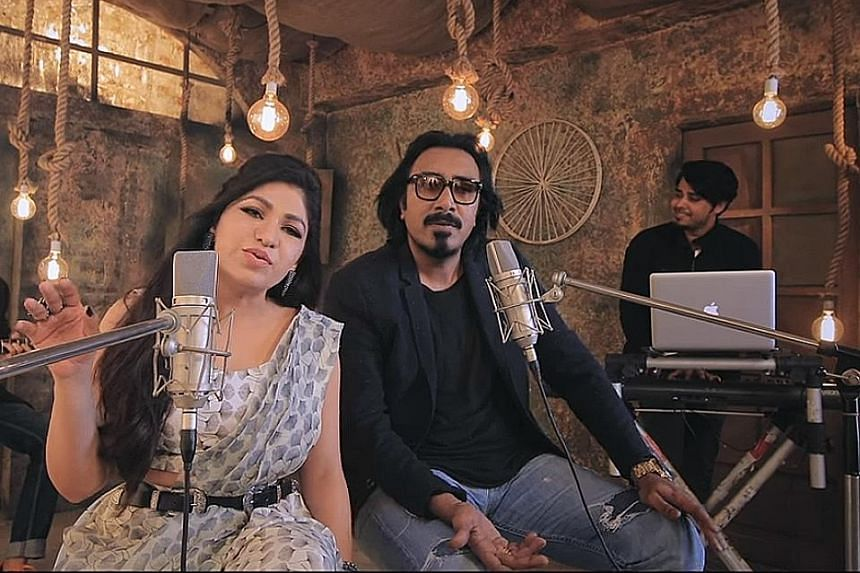 Popular Indian singers (from far left) Tulsi Kumar and Arko in a screengrab of a music video on T-Series, a video channel that is growing so fast it will likely dethrone PewDiePie (above) as the top channel on YouTube.