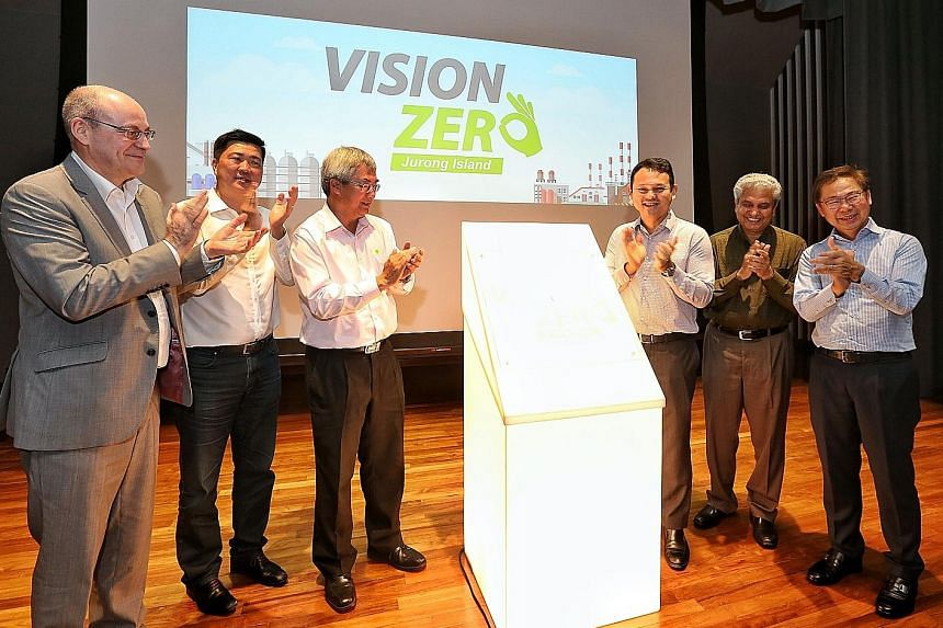 (From left) Mr Wim Roels, chairman of the Singapore Chemical Industry Council; Mr Charles Quek, president of the Association of Process Industry; Mr Lucas Ng, chairman of the Jurong Island Vision Zero Working Group; Mr Zaqy Mohamad, Minister of State