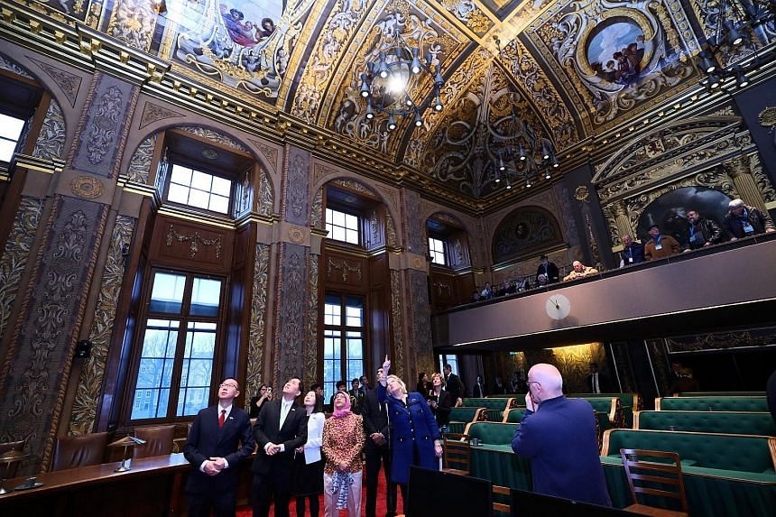 President Halimah Yacob touring the Plenary Hall located in the Binnenhof in The Hague. The building complex is the oldest House of Parliament in the world still in use. She was accompanied by (from left) Senior Parliamentary Secretary Tan Wu Meng, a