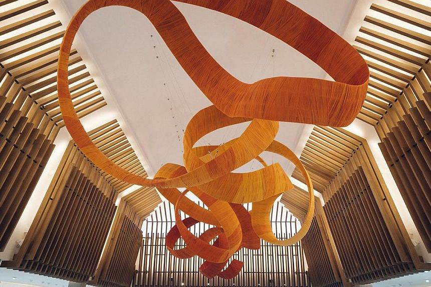 The T Galleria by DFS in Siem Reap, Cambodia, features reflecting pools, verdant gardens and works by local artists. This art installation in the central atrium was inspired by the warm colours of Buddhist monks' robes.